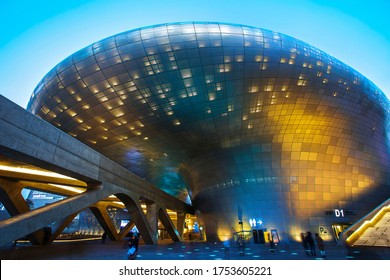 Night view of Dongdaemun Design Plaza(DDP), Jung-gu, Seoul, South Korea - January 3, 2020: Tourist are enjoying the Seoul Light Festival. laser beams are shining on the building's exterior walls