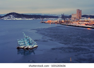 night view of downtowh harbour of Oslo, Norway. light reflections in water. winter time.