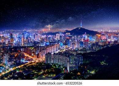 Night View of downtown cityscape and Seoul tower with Milky way in Seoul, South Korea.