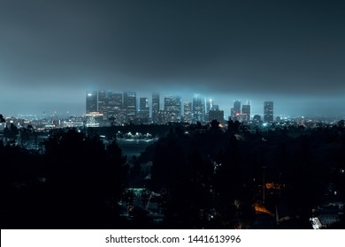 a night view of Downtown Los Angeles during a rain.