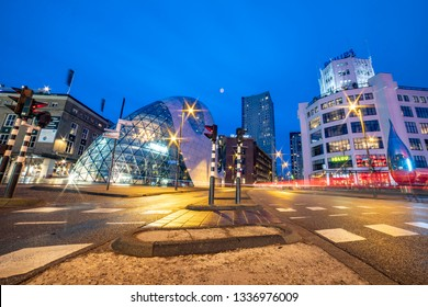 Night view of Eindhoven city center with  modern futuristic architecture in Europe, De Blob, the underground bicycle parking and view of the old Philips factory. Eindhoven, Netherlands - March 6, 2019