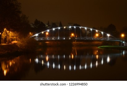 night view of Emil Pitter footbridge for pedestrians and cyclists across the Vltava river in Ceske Budejovice, southern Bohemia, Czech Republic