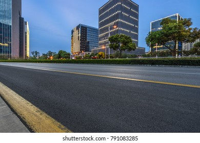 night view of Empty asphalt road through modern city, China