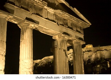 Night view of the Erechtheum, located at the Acropolis of Athens, picture taken from the Roman Agora, with the ruin of the main gate clearly vissible