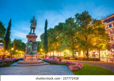 Night View Of Esplanade Park. Statue Of Johan Ludvig Runeberg in Helsinki, Finland