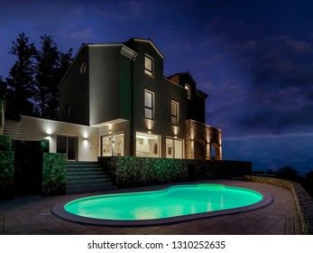 night view of the exterior modern villa in the foreground illuminated swimming pool