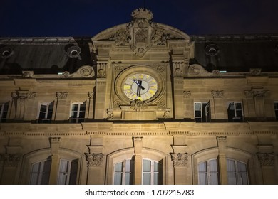 Night view of the famous clock on the facade of the Gare Saint-Lazare in the center of Paris, France.