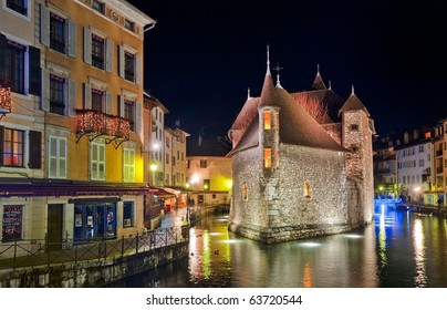 Night view of famous medieval castle Palais d'Isle - Palace of Isle - in Annecy, Savoy, France in festive illumination