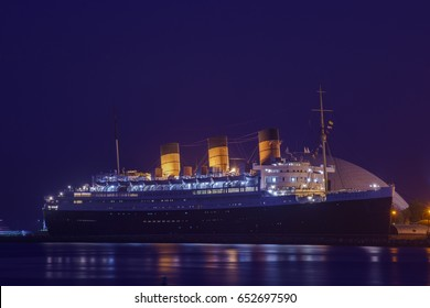 Night view of the famous Queen Mary near Rainbow Harbor, Long Beach, California, U.S.A.