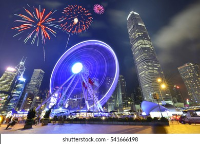 Night view and fireworks at ferris Wheel in Hong Kong City.