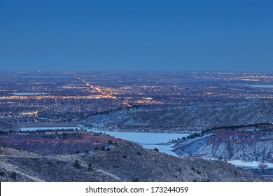 night view of Fort Collins in Colorado with foothills and Horsetooth Reservoir, winter scenery
