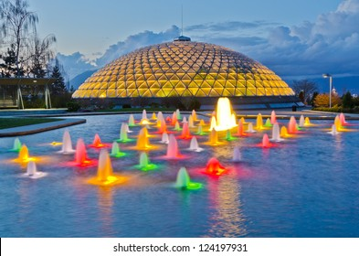 Night view at fountain in Queen Elizabeth park over mountain and cloudy sky in Vancouver, Canada.