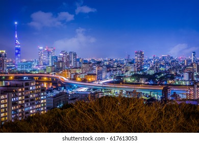 Night view of Fukuoka City, Japan, from Atago Shrine in early spring, featuring Fukuoka Tower, Momochi, Ohori Park, the Muromi River and the urban expressway