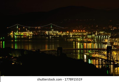 Night view of the Lion's Gate Bridge, Ironworkers Memorial Second Narrows Crossing and Second Narrows Rail Bridge in Vancouver BC Canada.
