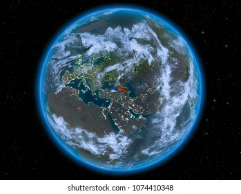 Night view of Georgia highlighted in red on planet Earth with atmosphere and clouds. 3D illustration. Elements of this image furnished by NASA.