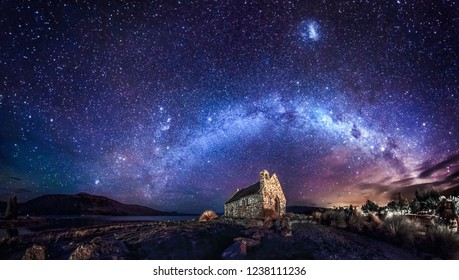 Night view of Good Shepherd Church by Lake Tekapo under the starry sky with milky way in New Zealand