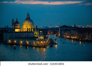 Night view of Grand Canal and basilica di santa maria della salute in Venice in Italy