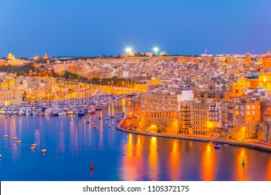Night view of the grand harbour marina near Birgu, Malta