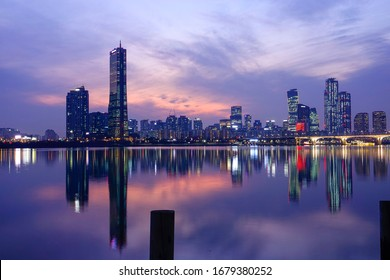 Night view of Han River after sunset with the background of 63 Building and high-rise buildings at Yeouido, Seoul, Korea