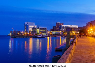 Night view of harbor and downtown buildings, in Halifax, Nova Scotia, Canada