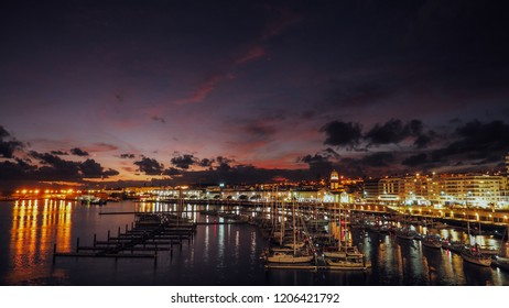 Night view of harbor at Ponta Delgada, Azores at Sao Miguel Island at epic sunset. Ocrober 10, 2018. Azores, Portugal.