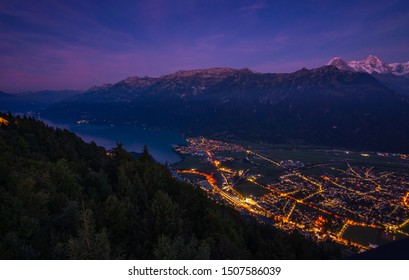 night view from Harder Kulm down on lake Brienz and Interlaken with Eiger, Mönch and Jungfrau in the back