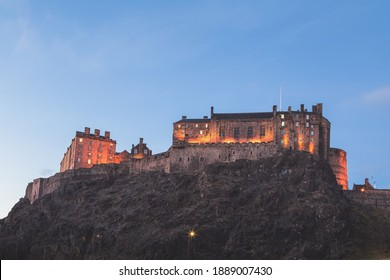 Night view of the historic medieval tourist attraction Edinburgh Castle perched atop Castlehill in Edinburgh, Scotland.
