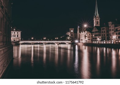 Night view of historic Zurich city center with famous Fraumunster Church, canton of Zurich, Switzerland. Evening summer day
