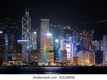 Night view of Hong Kong Island skyline from Kowloon side. Skyscrapers on waterfront in business center of Hong Kong. Hong Kong is a global financial center and a popular tourist destination of Asia.