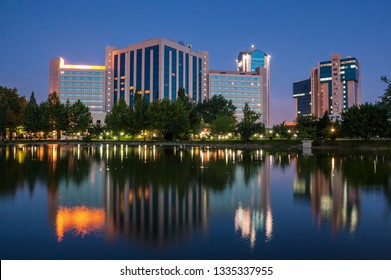 Night view of the hotel with a reflection in the water of Tashkent.Uzbekistan