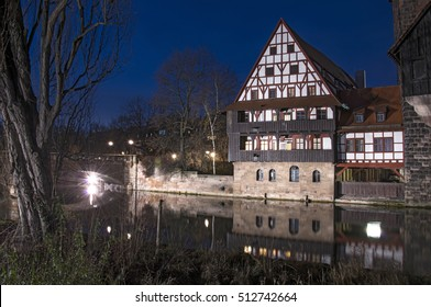 Night view of houses with traditional Bavarian architecture, on the edge of the river Pegnitz, in the German city of Nuremberg