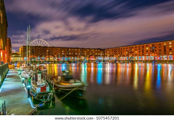 Night view of illuminated albert dock in Liverpool, England
