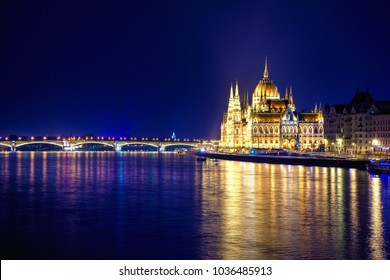 Night view of illuminated Budapest with Danube river, parliament, bridge, Hungary.