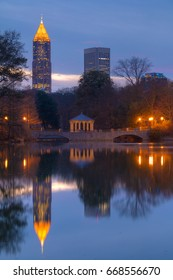 Night view of illuminated skyscrapers of Midtown and Downtown Atlanta and Lake Clara Meer in the Piedmont Park, USA
