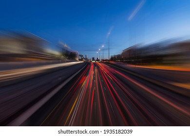 Night view of Interstate 75 and 85 freeways with motion blur near downtown Atlanta Georgia.