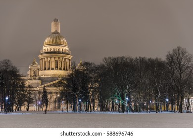 A night view of Isaakievskiy Cathedral behind trees in St Petersburgs, Russia