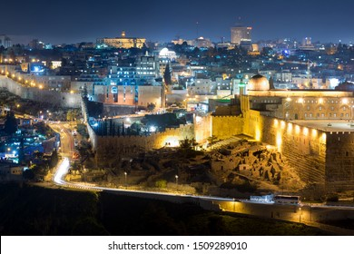 Night view of Jerusalem, Israel showing Old City, Al-Aqsa Mosque, the ancient wall and the new part of the city illuminated in background. UNESCO World Heritage Site.