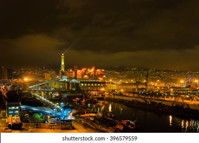 Night view of La Lanterna, ancient lighthouse and symbol of the city of Genoa, Italy