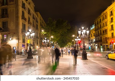 Night view of La Rambla street at the heart of Barcelona, Spain