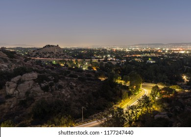 Night view of landmark Stoney Point rock formation and the San Fernando Valley area of Los Angeles, California.
