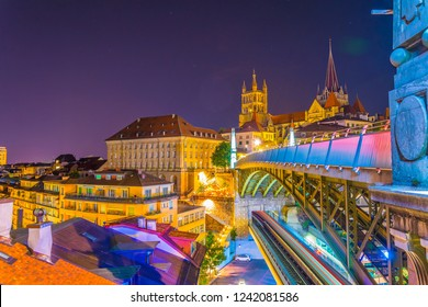 Night view of the Lausanne gothic cathedral Behind Charles Bessieres bridge, Switzerland