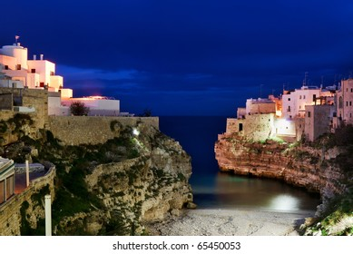 "Night  view of little village ""Polignano a mare"" and it's bay in  south Italy"