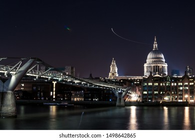 Night view to London Bridge and St Pauls cathedral, London UK