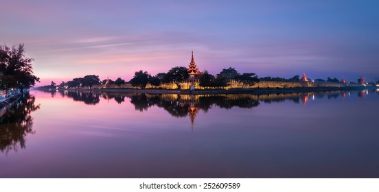 Night view of Mandalay cityscape with famous Fort or Royal Palace. Myanmar (Burma) travel landscapes and destinations. Three images panorama