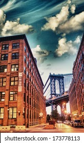 Night view of Manhattan Bridge between Brooklyn Buildings.