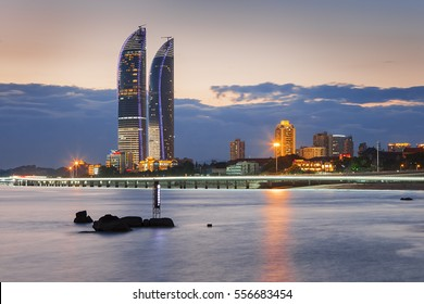 Night view of modern buildings of Xiamen beach during night, Fujian, China