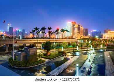 Night view of modern urban high-rise buildings, Nanning, China.