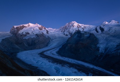 Night view of the Monte Rosa mountain massif, seen from the famous Gornergrat near Zermatt, Switzerland.