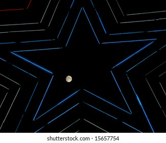 Night view of the moon transiting through the Mill Mountain Star in Roanoke, Virginia.