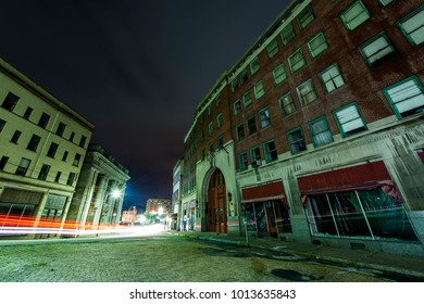A night view of a mostly abandoned downtown in Brownsville, Pennsylvania.
